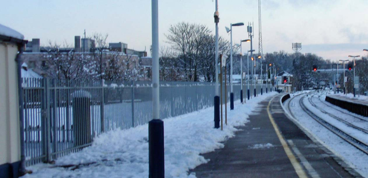 Aldershot train station in the snow. View towards the Recreation Ground.