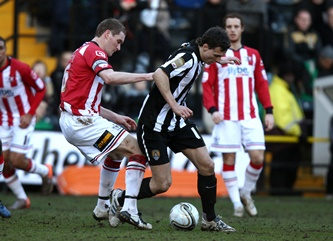 Notts County's Alan Gow is tackled by Exeter City's Matthew Taylor