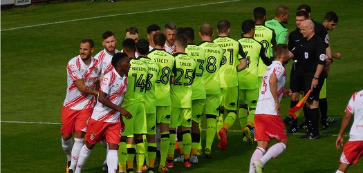 Hand shake between Stevenage and Exeter City players