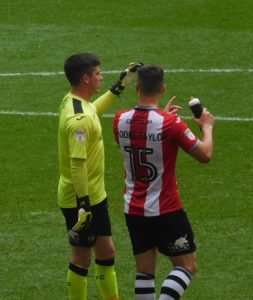 Christy Pym and Jordan Moore-Taylor talking together at Wembley in the Coventry vs Exeter game
