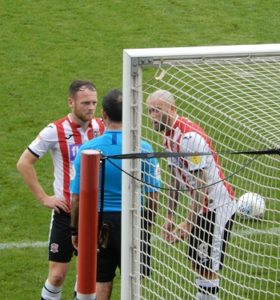 Jake Taylor and Nicky in discussion with the referee in the Forest Green game